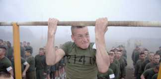 A Marine Corps recruit does pull-ups during a physical fitness test at Marine Corps Recruit Depot San Diego, CA.