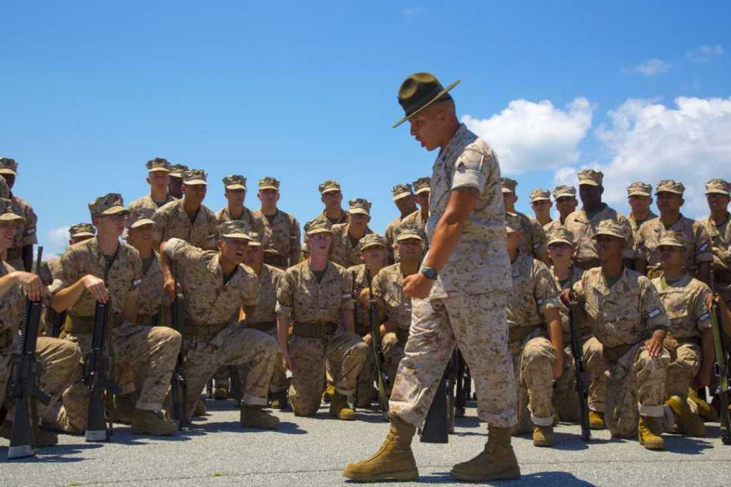 U.S. Marine Staff Sgt. Jeremy Bolanos, drill master, 1st Recruit Training Battalion, Recruit Training Regiment, Marine Corps Recruit Depot Parris Island, demonstrates a drill movement to recruits aboard Marine Corps Recruit Depot, Parris Island.