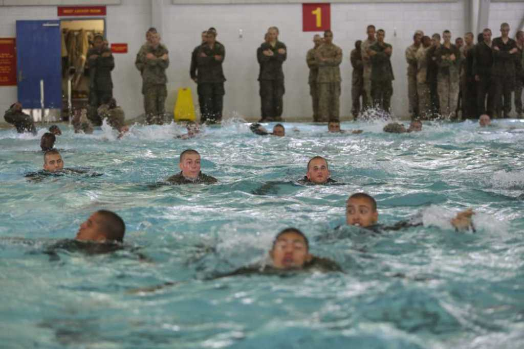 Recruits of Bravo Company, 1st Recruit Training Battalion, make their way across the pool during the a 25-meter swim portion of the Water Survival Basic Qualification at Marine Corps Recruit Depot San Diego.
