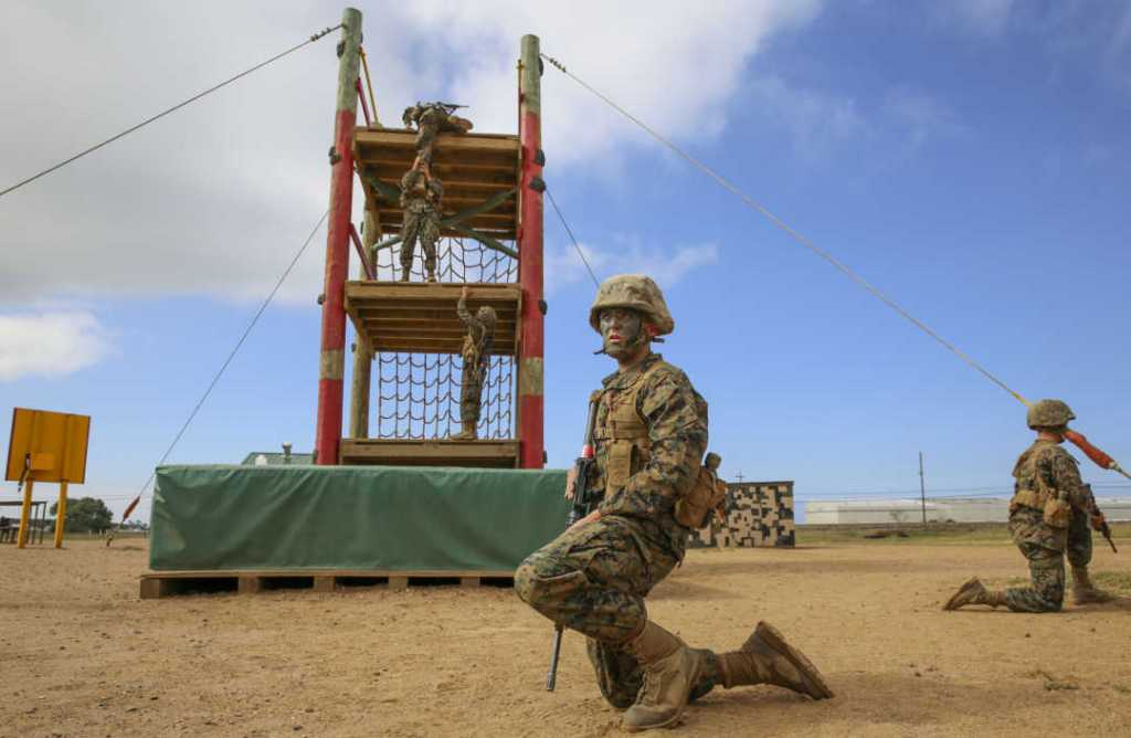 Private Joseph A. Pratt, Alpha Company, 1st Recruit Training Battalion, waits for his turn to climb an obstacle during the Crucible at Marine Corps Base Camp Pendleton.