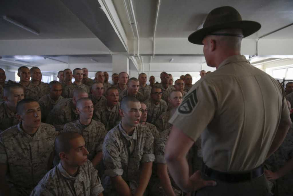 Recruits from Alpha Company, 1st Recruit Training Battalion, receive instructions from a drill instructor during pick up at Marine Corps Recruit Depot San Diego.