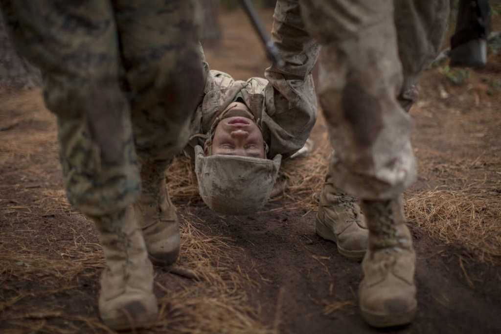 United States Marine Corps Rct. Dave Ortiz of Platoon 1004, Charlie Company, 1st Recruit Training Battalion, simulates being a casualty during a Crucible event on Parris Island, S.C.
