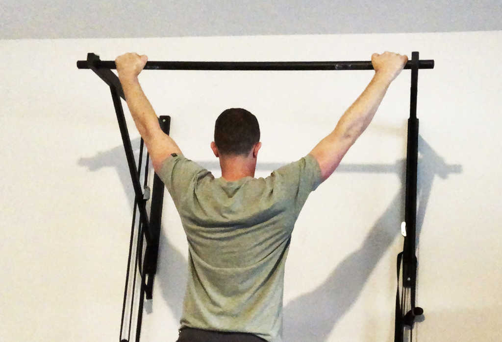 How to do more pull ups: master the basic dead hang pull up position.