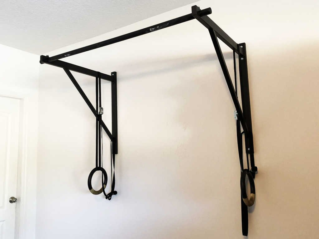 The Titan Fitness Wall Mounted Pull Up Bar mounted in a garage.